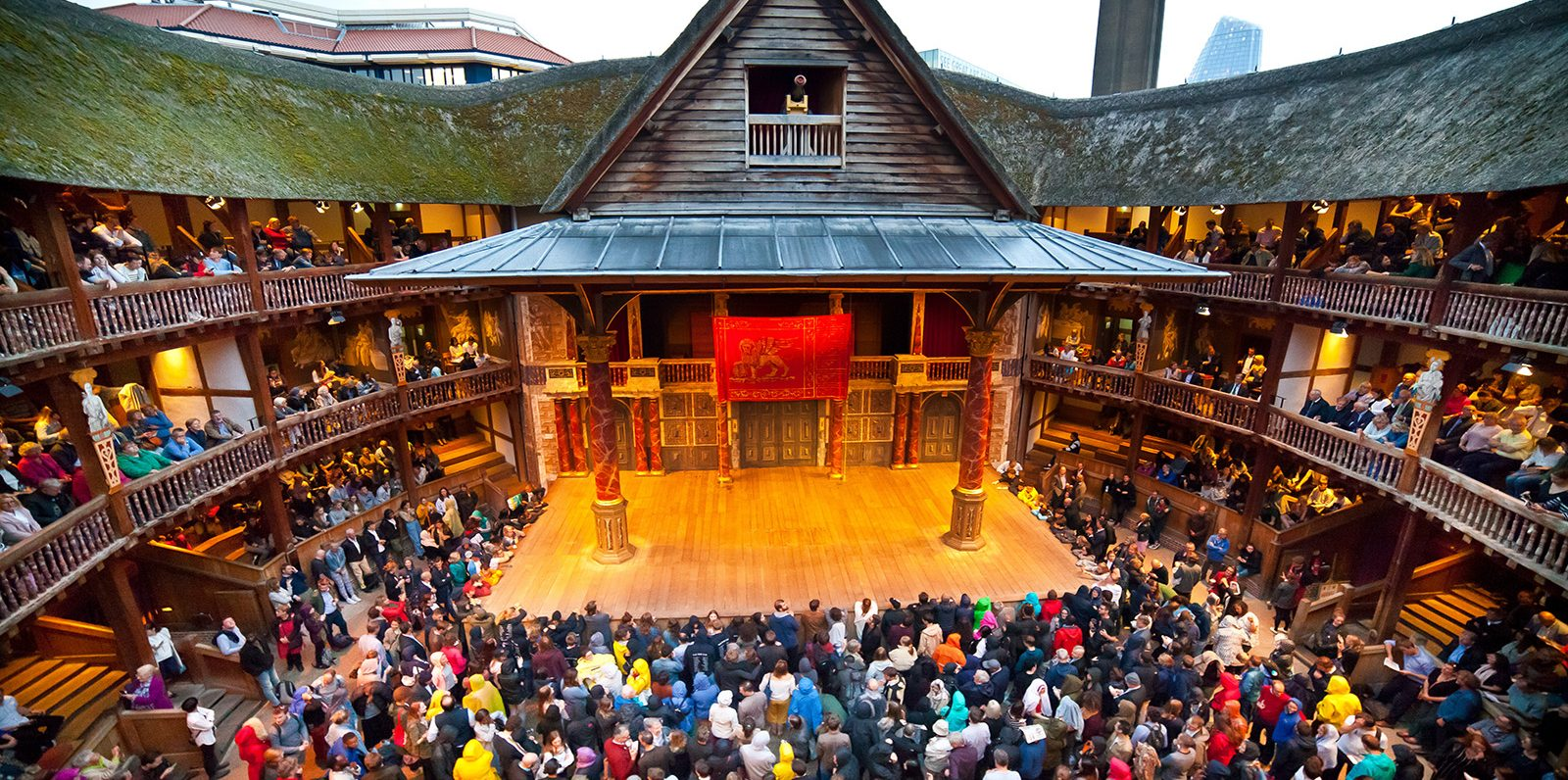 Photograph of the Globe Theatre interior and audience during a production