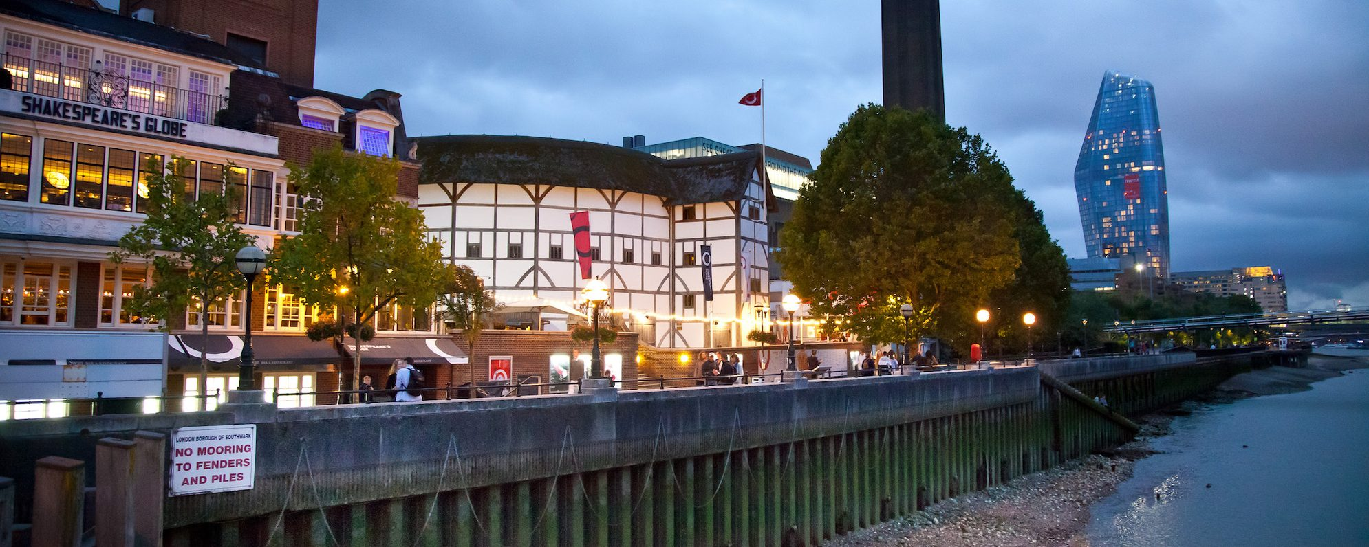 Shakespeare's Globe by the riverside at night time
