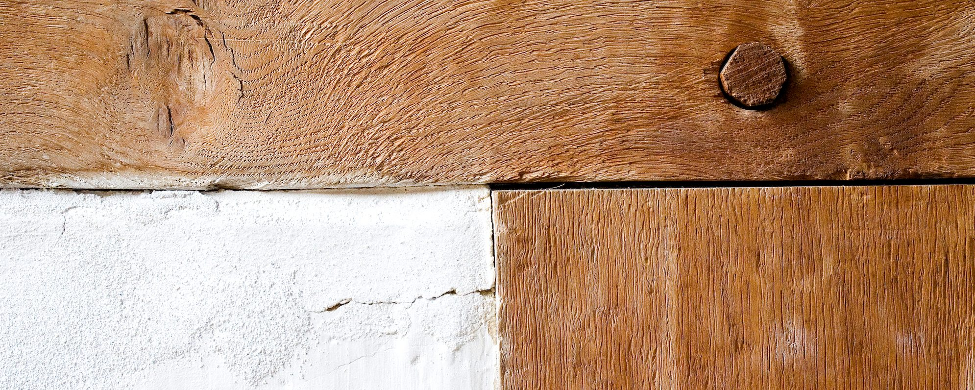 A close up of a wooden frame on a building