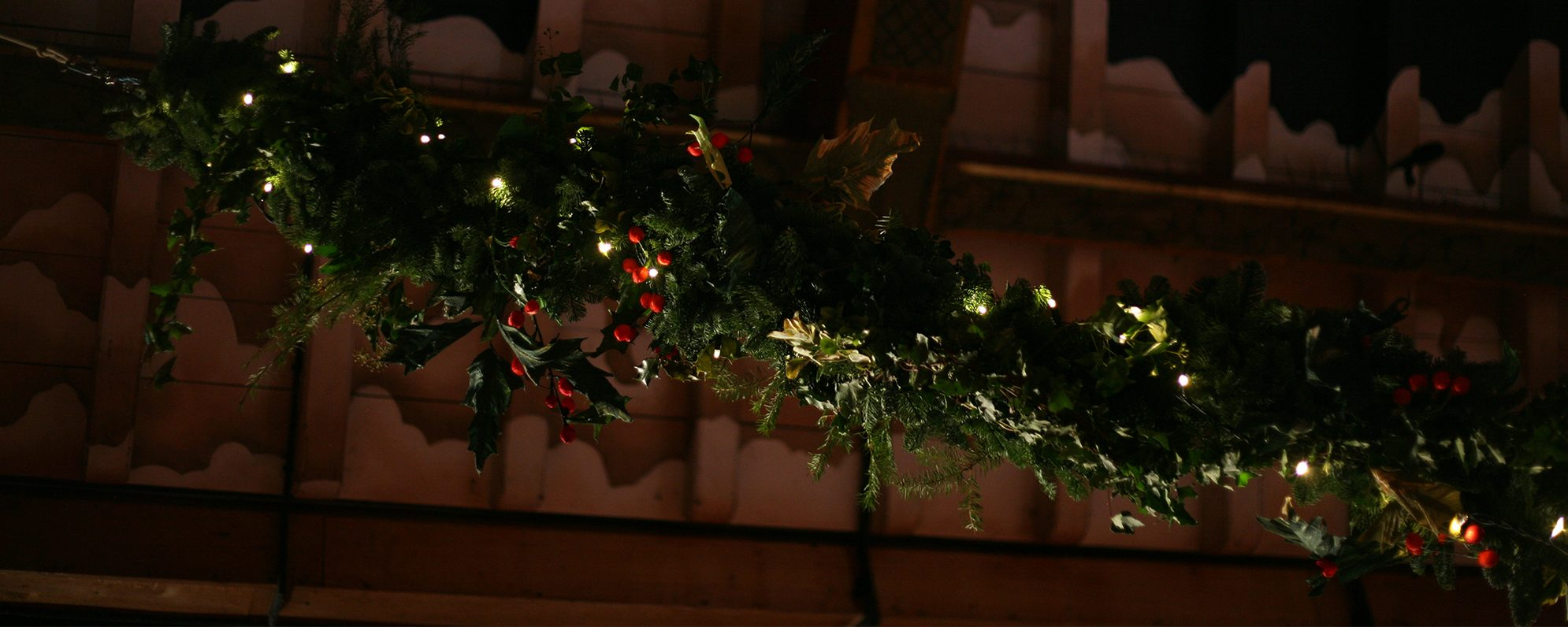 A holly bower with Christmas decorations