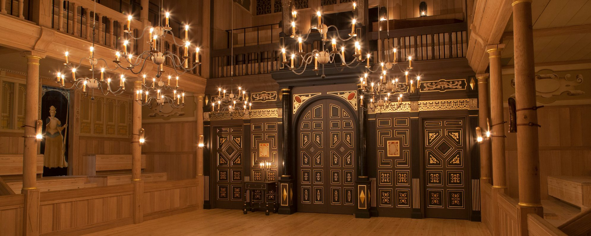 An indoor wooden playhouse lit by candles