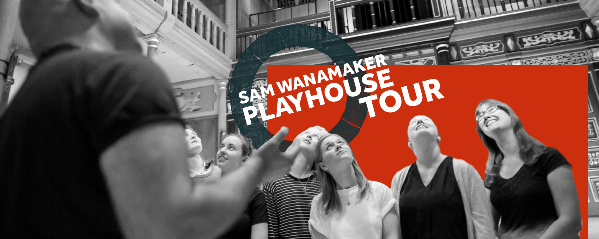 A tour group look up to the ceiling of the Sam Wanamaker Playhouse